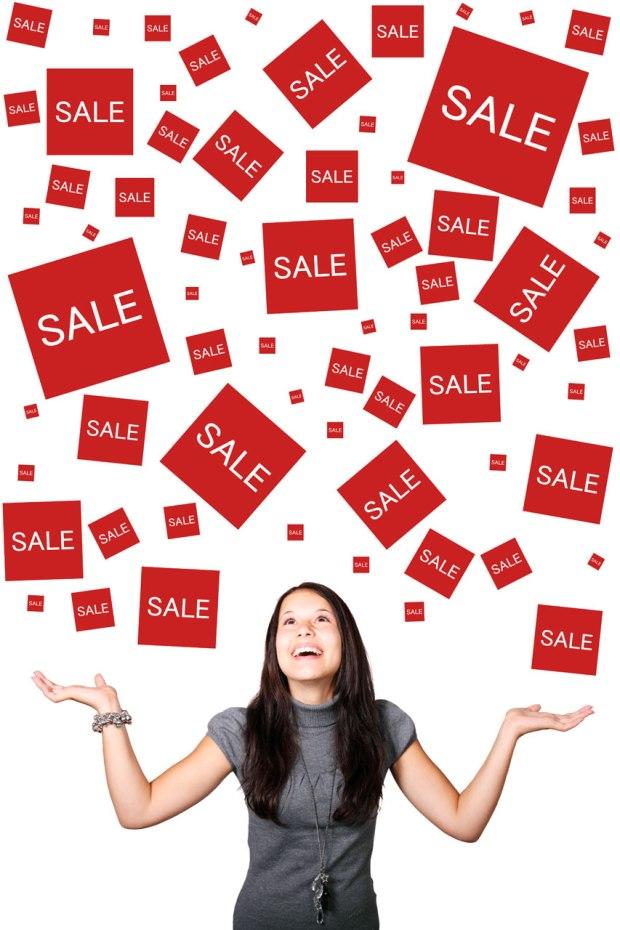 10561-a-beautiful-girl-enjoying-sales-signs-pv