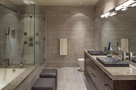 modern-bathroom-design-ideas-with-bathrom-concrete-floor-finishes-and-built-in-bathtub-also-two-small-ottomans-facing-marble-bathroom-vanity-plus-large-mirror-945x630